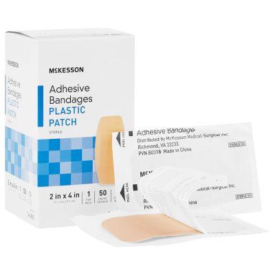 "McKesson 16-4825 Plastic Patch Adhesive Bandages, 2"" x 4"" Rectangle, Tan, Sterile - 1200 / Case"